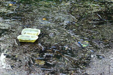 Garbage floating on water photo