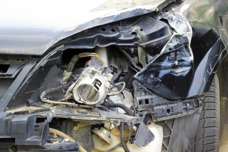 severely: Crashed car close up. The front part is severely damaged. Stock Photo