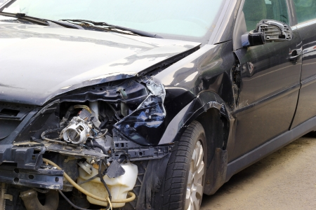 Crashed car close up. The front part is severely damaged. Stock Photo