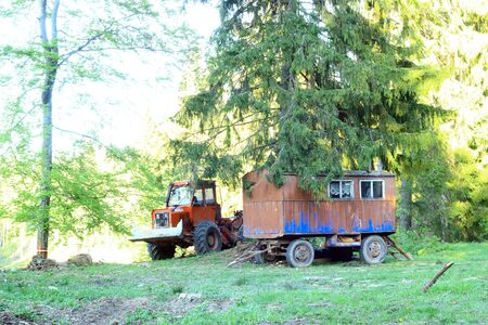 Tractor next to devastated forest, in the middle of a national park.