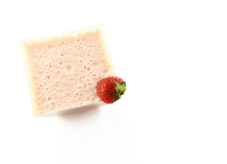 Strawberry milkshake in pretty glass, isolated on white. Empty space for text.