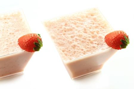 Strawberry milkshake in pretty glass, isolated on white.  Stock fotó