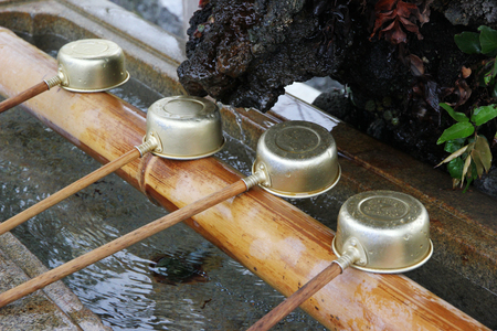 Purification basin at a shinto shrine  Ladles close up