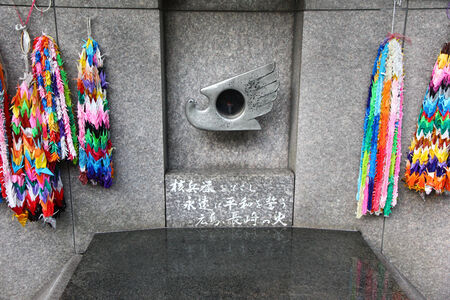 TOKYO, UENO - NOVEMBER 2013. Atomic bomb monument called The flame of Hiroshima and Nagasaki. It is said that a man took a burning flame from his houses remaints in Hiroshima.  It was kept as reminder of the tragedies caused by the atomic bomb and its Editorial