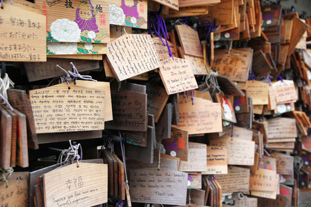 TOKYO - NOVEMBER 2013. Ema prayer tables at Toshogu Shrine. Ema are small wooden plaques used for wishes by shinto believers.
