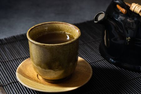 Japanese green tea in a traditional and beautiful clay cup. Japanese dishes and tableware. Reklamní fotografie