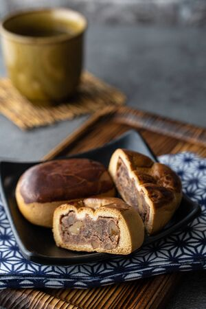Manju, a traditional Japanese sweet snack often served with green tea.
