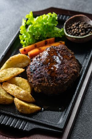 Japanese Hamburg Steak, a popular grilled meat patty served with potatoes, vegetables or rice.
