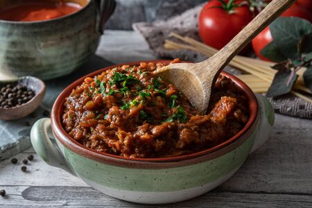 Bolognese tomato and beef sauce in rustic bowl. Traditional Italian sauce used for pasta. Reklamní fotografie