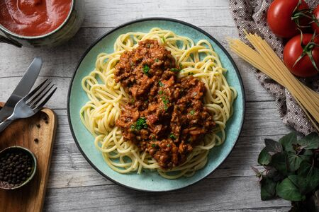 Bolognese pasta overhead view. Traditional Italian pasta with a beef and tomato sauce.