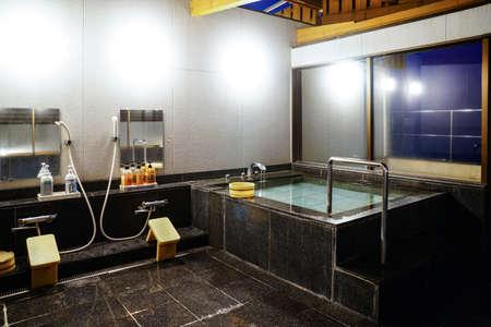 Indoor Japanese hot springs bath (onsen).