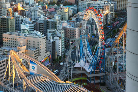 Amusement park in the center of Tokyo. Roller coaster intertwining with skyscrapers. Redakční