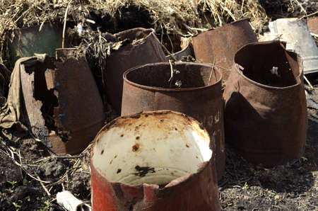 battered land: rusty bucket