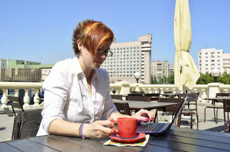 business woman drinking coffee at outdoor cafe photo