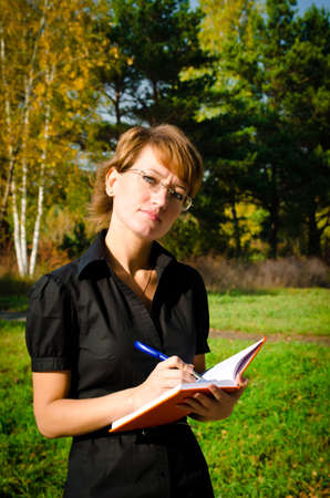 Business woman taking notes on a pad Stock Photo - 15891631