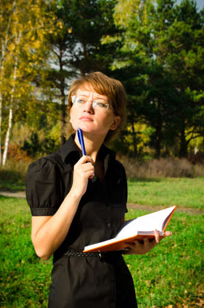 Business woman in autumn park Stock Photo - 15891630