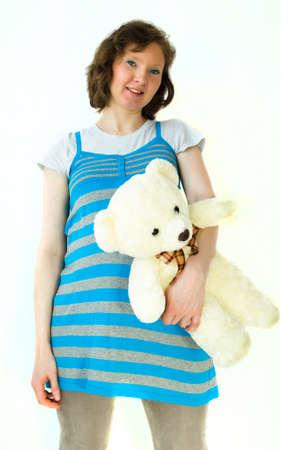 Lady pregnant with teddybear Stock Photo - 19214838