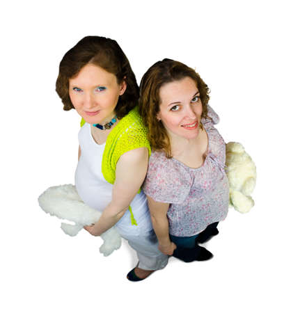 Two pregnant women play with teddy toys photo