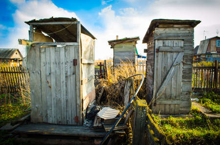 rustic toilets at their summer cottage photo