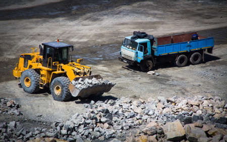 open trench: Mining careers with industrial car Stock Photo