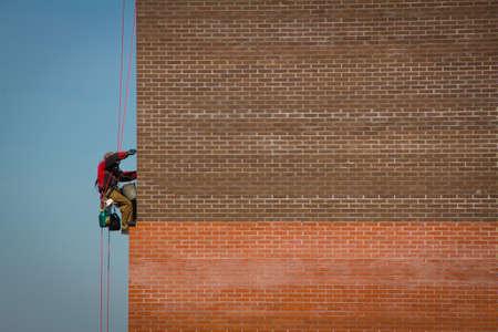 steeplejack: Steeplejack Builder worker plastering industrial building facade