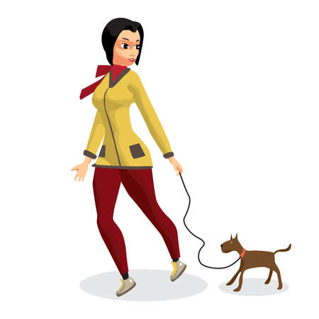 Young woman walking with a dog.