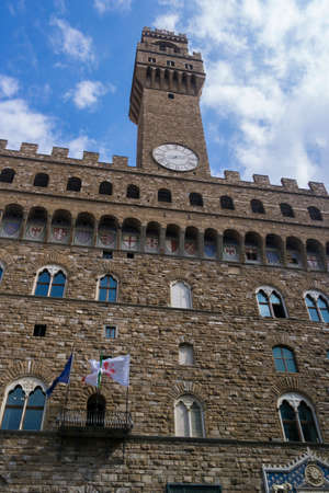 SIENA, ITALY - SEPTEMBER 7, 2016. Square Piazza del Campo with medieval architecture. The mangia tower, view from the courtyard