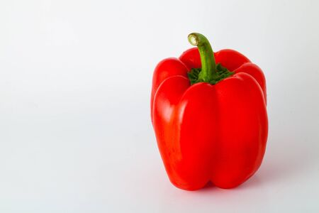 a red pepper on white background