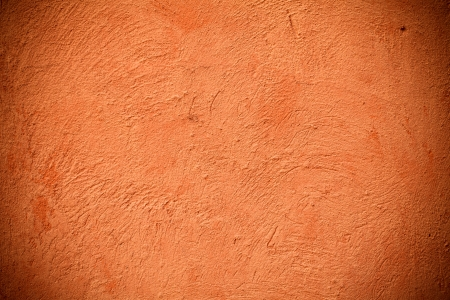background of a orange wall outside of a home photo