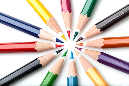 many color pencils on white background photo