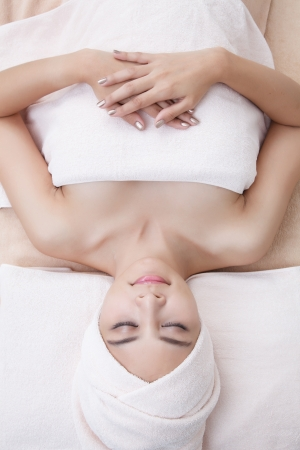 beautiful asian girl in spa on spa bed photo