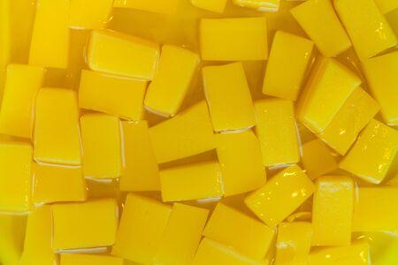 gelatine: close up yellow jelly in  syrub Stock Photo