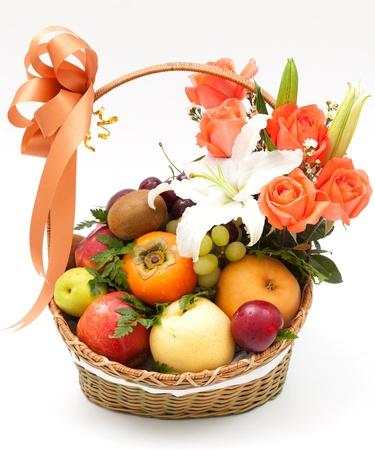 fruit basket with flower on white background photo