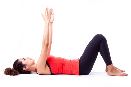 woman in pilates action ( isolated ) photo
