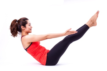 woman in pilates action ( isolated ) Stock Photo