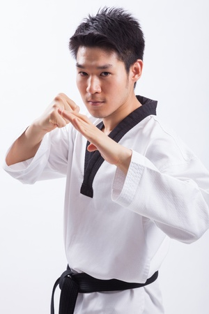 taekwondo action isolated by a young man