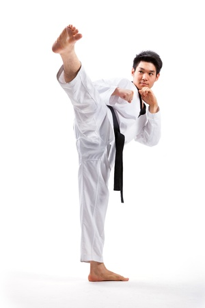 taekwondo action isolated by a young man photo