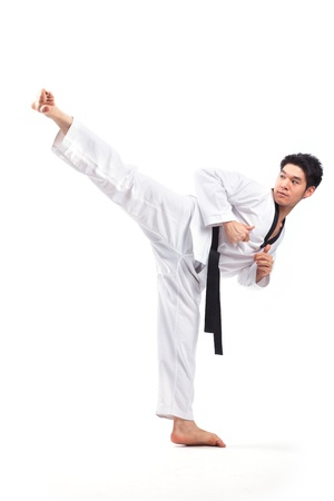 black belt: taekwondo action isolated by a young man