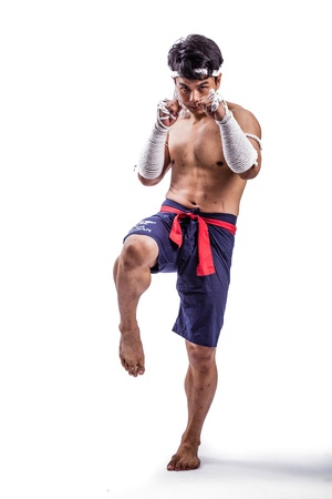 a thai boxer with thai boxing action Stock Photo