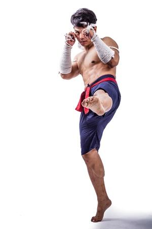 a thai boxer with thai boxing action Stock Photo