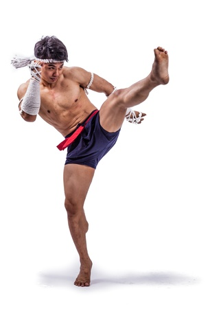 boxers: a thai boxer with thai boxing action Stock Photo