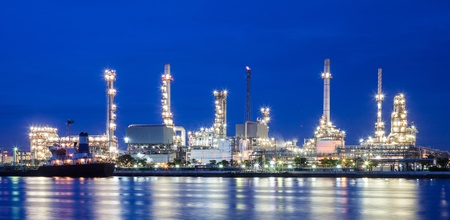 Oil refinery and blue sky near a river at thailand photo