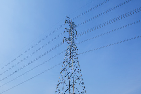 tall electricity post in blue sky and daylight