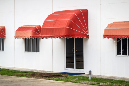 awning: red awning decorate on the building Stock Photo