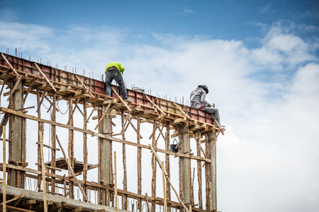 foreman and worker in construction site Stock Photo