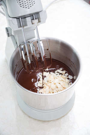 beating: preparing brownie dough with dough mixer