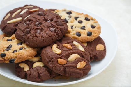 chocolate chip cookies and almond cookies photo