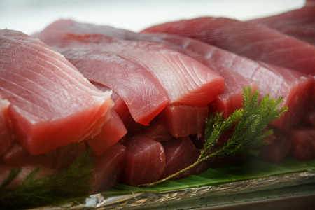 some tuna sashimi in a glass box wait for eat Stock Photo