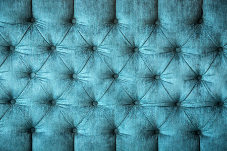 close up of a turquoise velvet sofa