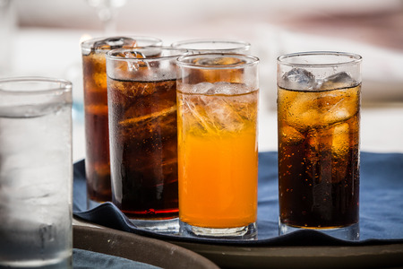 cold beverages: many soft drink are on a tray
